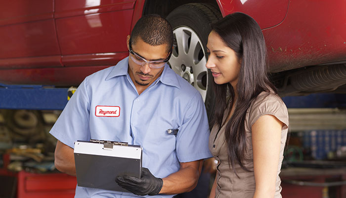Automotive Mechanic talking to a customer